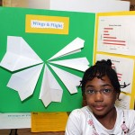"Helen Meade, 8, made paper airplanes with varying wingspans to see which would fly the furthest. She thought the widest winged plane would fly the best, but the opposite proved true. ""I'm really good at making paper airplanes,"" she said."