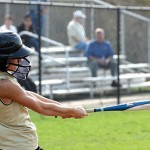 Woodland's Lindsay Boland connects with the ball on Monday versus Naugatuck. The Hawks topped the 'Hounds 15-8. -LARAINE WESCHLER