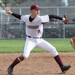 Naugatuck's Adam Neveski throws to first during the Hound's game against Crosby May 9. - PHOTO BY LARAINE WESCHLER