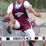 Naugatuck's Andres Jiminez clears a hurdle during Naugatuck's home track meet May 5. - PHOTO BY LARAINE WESCHLER