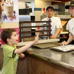 Western Elementary School teacher Michelle Baker, right, takes an order from Johnny Cordeiro, 7, and his mother, Danielle Cordeiro during Teacher's Night at McDonalds on Rubber Avenue in Naugatuck. Ten teachers worked at McDonald's from 5-8 p.m. June 2 to raise money for the school. Ten percent of sales will be donated to the school.